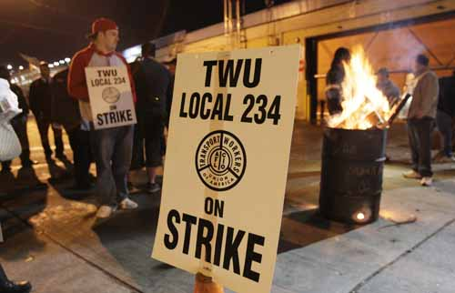 Striking SEPTA workers keep warm by a fire behind the SEPTA depot on Penn St. just behind the Frankford Transportation Center on Nov. 3, 2009.   ( Elizabeth Robertson / Staff Photographer )