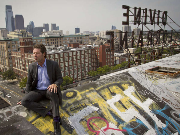 Eric Blumenfeld, president of EB Realty Management Corporation, looks at the skyline from the roof of the Divine Lorraine Hotel on August 24, 2012. ( MICHAEL S. WIRTZ / Staff Photographer )