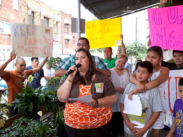 Erika Almiron, executive director of Juntos, speaks during a South Philadelphia rally Wednesday, July 3, 2013 to bring attention to last week's arrests nearby, and recent raids by federal officials in immigrant communities. ED HILLE / Staff Photographer