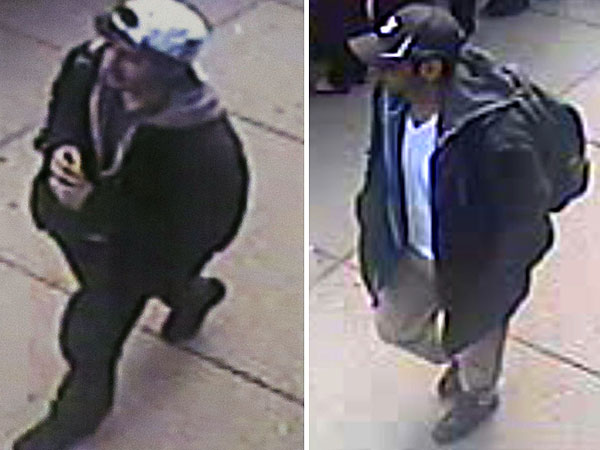 This combination of Associated Press file images released by the FBI on Thursday, April 18, 2013, show two images taken from surveillance video of  what the FBI are calling suspect number 2, left, in white cap,and suspect number 1, right, in black cap, as they walk near each other through the crowd in Boston on Monday, April 15, 2013, before the explosions at the Boston Marathon. (AP Photo/FBI)