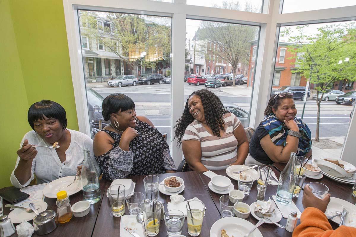 From left, Shirley Morrison, LaRissa Miller, Cynthia Taylor, and Rhonda Washington enjoy dinner at EAT Cafe.<br />
