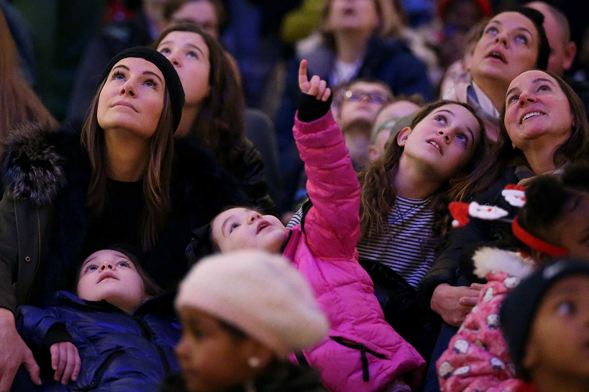 Karen Builione, top left, watches the holiday light show with her daughters Isabella, 7, in blue, and Francesca, 4, in pink, in Macy´s at 13th and Market streets on Friday, Nov. 24, 2017.