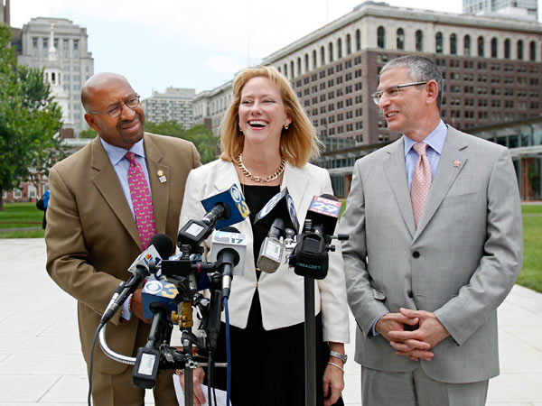 Flanked by Mayor Nutter and Robert Ciaruffoli (right), Donna Crilley Farrell talks about Pope Francis' itinerary for his visit. (MICHAEL BRYANT/STAFF PHOTOGRAPHER)