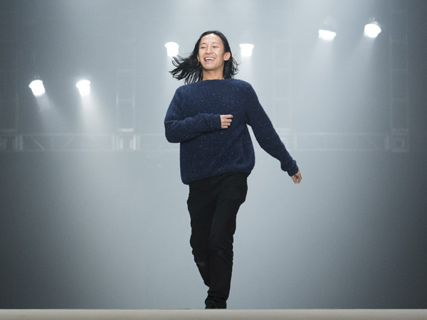 Designer Alexander Wang greets the audience following his Fall 2013 fashion show during Fashion Week, Saturday, Feb. 9, 2013, in New York. The designer is the latest to announce a collaboration with Swedish retailer, H&M. (AP Photo/John Minchillo)