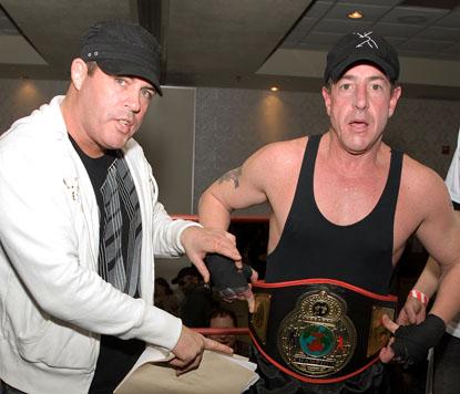 Damon Feldman puts the Celebrity Boxing Federation championship belt on Michael Lohan in happier times. Photo: Splash News.