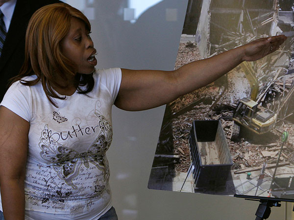 Felicia Hill points to a photo of the Salvation Army building, when telling her story of how she escapedfrom Wednesday´s building collapse. Hill was working in the Salvation Army thirft shop at the time of the collapse, and was pulled from the building by a bystander. June 10, 2013.  (LUKE RAFFERTY/Staff Photographer)