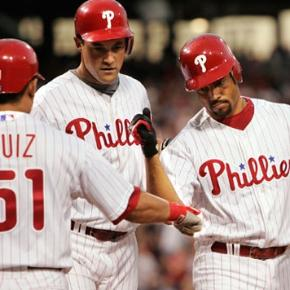 Carlos Ruiz congratulates Pedro Feliz and Pat Burrell after they scored on Feliz´ home run.