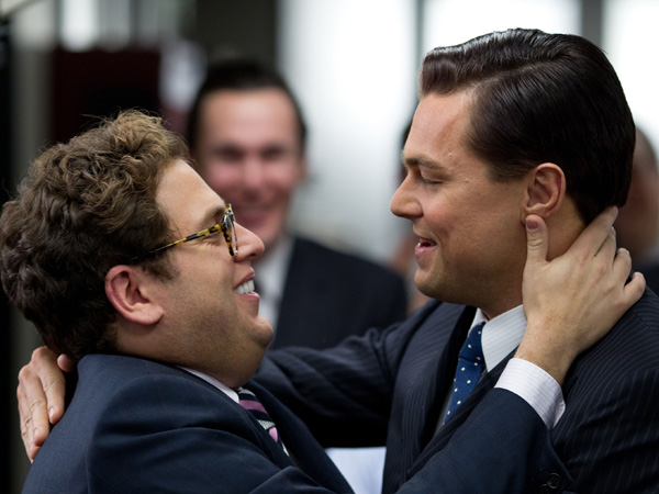 """This film image released by Paramount Pictures shows  Jonah Hill, left, and Leonardo DiCaprio in a scene from """"The Wolf of Wall Street."""" (AP Photo/Paramount Pictures and Red Granite Pictures, Mary Cybulski)"""