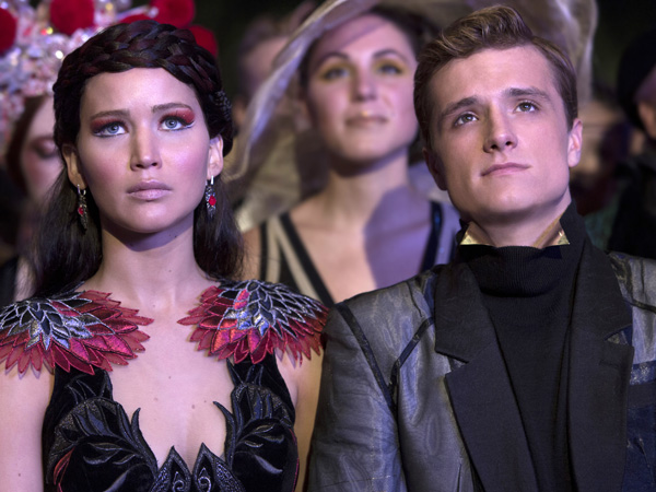 "This image released by Lionsgate shows Jennifer Lawrence as Katniss Everdeen, left, and Josh Hutcherson as Peeta Mellark in a scene from ""The Hunger Games: Catching Fire."" The film releases Nov. 22, 2013. (AP Photo/Lionsgate, Murray Close)"