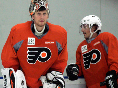 Philadelphia Flyers goalie prospect Niko Hovinen, lef of Finland, and Danny Briere take a break during an informal hockey practice at the team´s training facility, Thursday, Sept. 20, 2012, in Voorhees, N.J. The league locked out its players this month, its fourth shutdown since 1992. (AP Photo/Tom Mihalek)