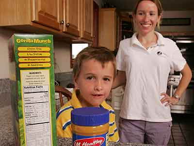 Margaret Sova McCabe and son Tommie at home in 2008 in Sanbornton, N.H., with some packages of food that contain food content warnings. Food allergies can turn mealtime into a real puzzler. (AP Photo / Jim Cole)