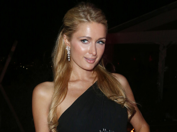 Paris Hilton arrives at the Worldview Entertainment´s Bungaow 8 Party in Cannes, southern France, Friday, May 17, 2013. (Photo by Joel Ryan/Invision/AP)