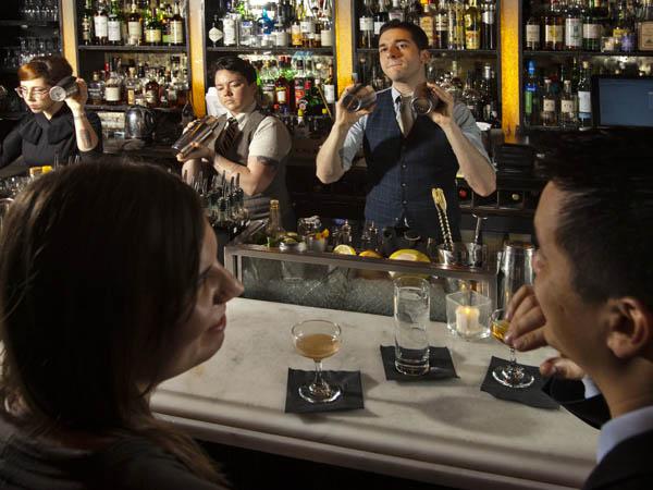 Bartenders (left to right) Sara Arment, Colin OÕNeil and Al Sotack mix drinks at Franklin Mortgage.  ( DAVID M WARREN / Staff Photographer )