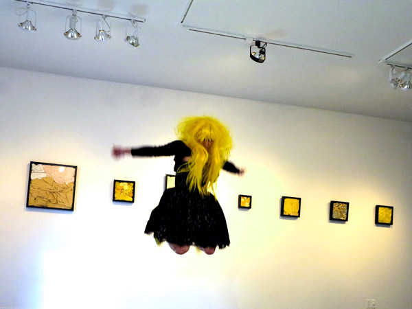 "Artist Sarah Hill during performance art piece ""I´m Fine"". Photo documentation by Patrick Altman at Le Lieu, centre en art actuel, Québec, Canada."