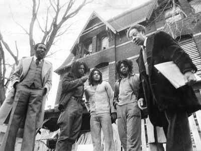 Comedian-activist Dick Gregory (left) meets with MOVE members Phil, Chuckie and Delbert Africa in March 1978. At right is Mercel Randolph, who worked with Gregory. (EDWARD J. FREEMAN/Inquirer)