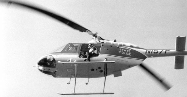 Helicopter hovers over the MOVE compound, moments before Lt. Frank Powell drops bomb.