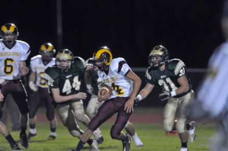 Gloucester Catholic's John DeLaurentis cuts back away from Seneca's Joey Pawlowski (44) and Adam Coppola on his way to a 95 yard opening kick off return for a TD.