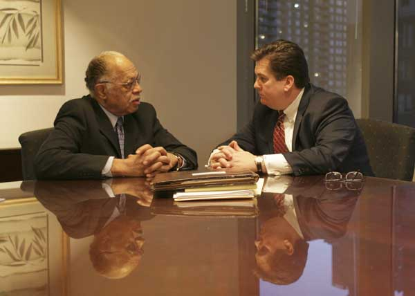 Dr. Kermit Gosnell (left) speaks with his lawyer William Brennan during a March meeting.  (Yong Kim / Staff Photographer)