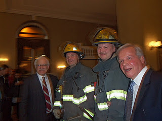 Jim Gardner poses with Philadelphia firefighters and his longtime colleague Dave Roberts during a brief commotion Saturday at the Arts Condo where his daughter was celebrating her Bat Mitzvah. Photo: Laura Goldman/NakedPhiladelphian.Blogspot.com