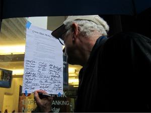 Participant signs Earth Quaker Action Team pledge.