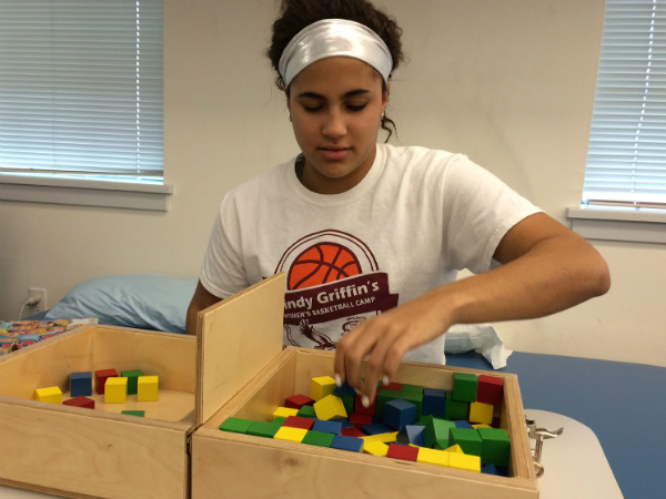 Avery Marz, a freshman on the Saint Joseph´s women´s basketball team, goes through an exercise to help her recover from a stroke.