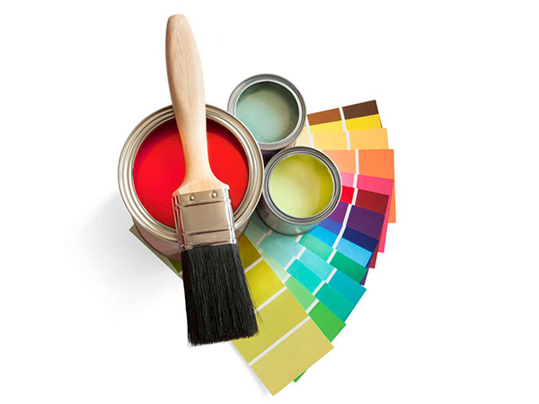 Colored swatches and paint pot and paintbrush on white background. (iStock photo)
