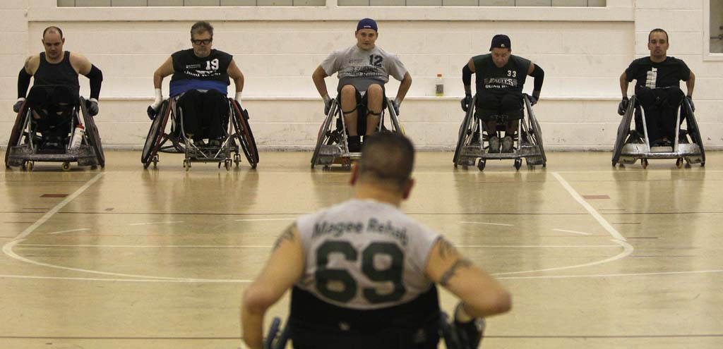 Wheelchair rugby, or quad rugby, originated in the late 1970s in Canada. Only a person with quadriplegia can qualify to play. However, the severity of the disability in the limbs equates to a point system used for the game. A maximum of eight points can be shared among four players on the court. John Benson, far right, is considered a 2.0 due to some of the functioning in his hands.  ( RON CORTES / Staff Photographer )
