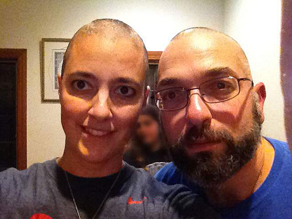 Amy Reed and Hooman Noorchashm after she began chemotherapy.  What Reed thought was a routine hysterectomy in Boston ended up spreading cancer. Reed and her husband, Noorchashm, both doctors, are campaigning against the procedure she had, known as morcellation.