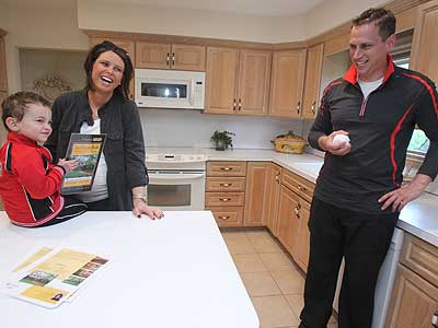 Stephanie Ritigstein and Michael Ritigstein touring a house in Cherry Hill as they seek bigger quarters for their growing family.  (Charles Fox / Staff Photographer )