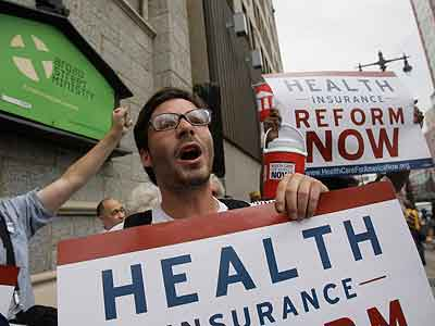 Health programs have been met with protest, such as this rally in Philadelphia in 2009. (AP Photo / Matt Slocum)