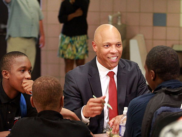 Dr. William R. Hite Jr., superintendent of The School District of Philadelphia, has lunch with 9th-grader John Span (left) and other South Philadelphia High School students in the cafeteria, on Monday Sept. 9, 2013. (DAVID SWANSON / Staff Photographer)