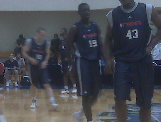 Jrue Holiday (19) warms up before the Sixers/Nets first Summer League game in Orlando.