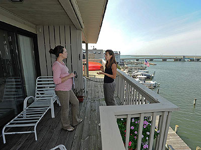 Real estate agent Sara Nemeth (left) with Jesssica Pellicciotta of Malvern, who is looking for a vacation home in Stone Harbor, where the  median price is up 87 percent from 2005 to 2011.<br />