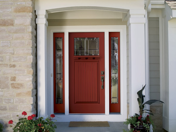 This undated photo provided by Therma-Tru Doors shows a red front door.  Bold colors are becoming increasingly popular options for front doors. Color expert Kate Smith predicts we´ll see more homes with doors painted in tropical blues, energetic oranges and deep purples in 2014. (AP Photo/Therma-Tru Doors, Brad Feinknopf)
