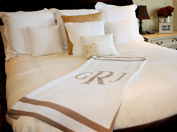 This photo provided by Girlytwirly.com shows a soft blanket embroidered with Mom´s initial which is a thoughtful gift.  This one comes in either acrylic or cashmere, and the trim and initial can be had in a wide range of color options.