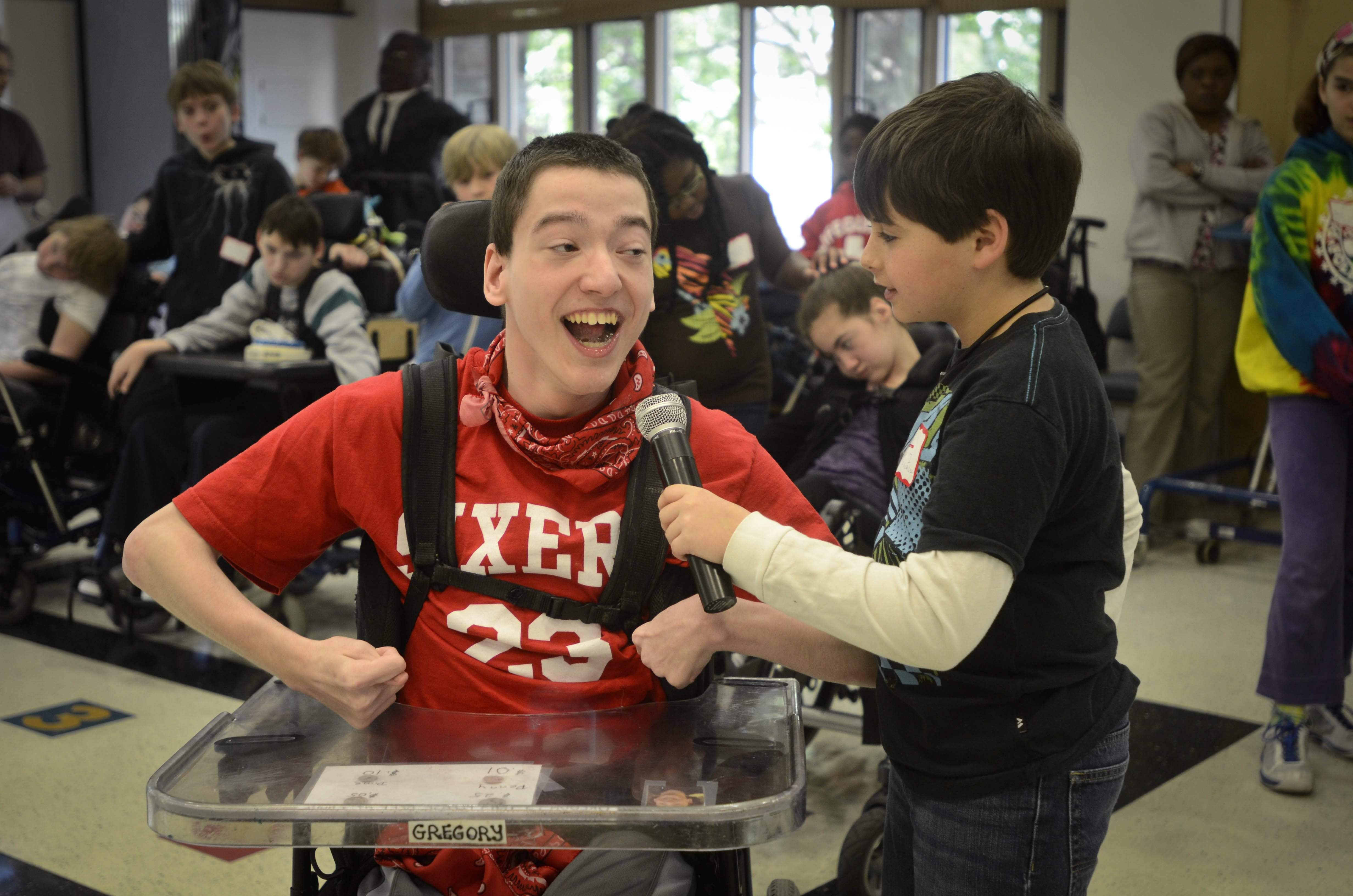"Germantown Friends student Max Marlow holds the mike for Greg Viola as they sing during dress rehearsal of the original play ""On the Other Side of the Fence."" It's the 30th anniversary ""Something Magical"" production with students from HMS School. RON TARVER / Staff Photographer"
