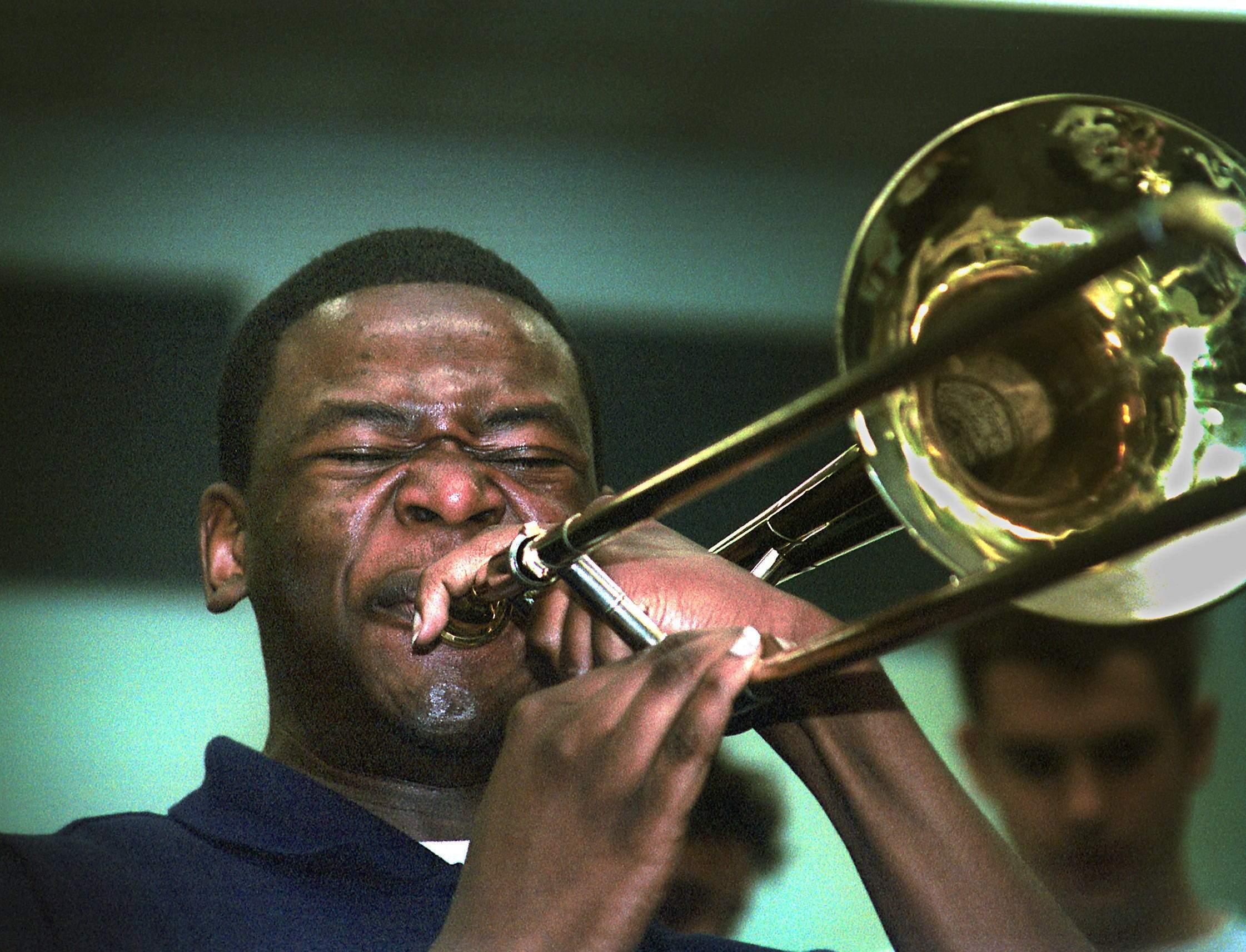 Ernest Stuart at 17, playing his trombone in 2001 as part of the Pennsauken High band. SHARON GEKOSKI-KIMMEL / Staff Photographer