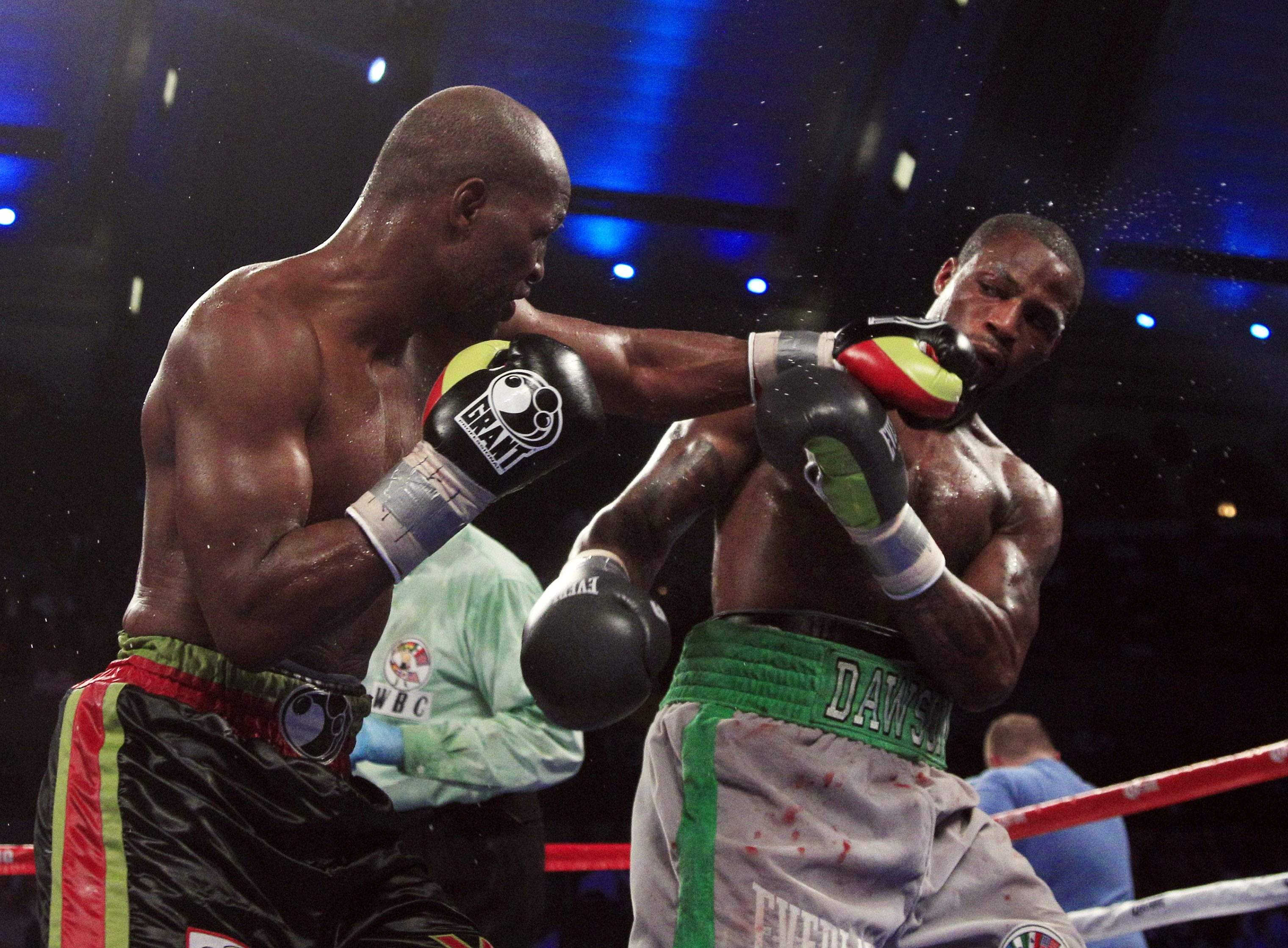 Bernard Hopkins, left, hits Chad Dawson with a left in the 11th round of their  light-heavyweight fight.<br /><br />Associated Press