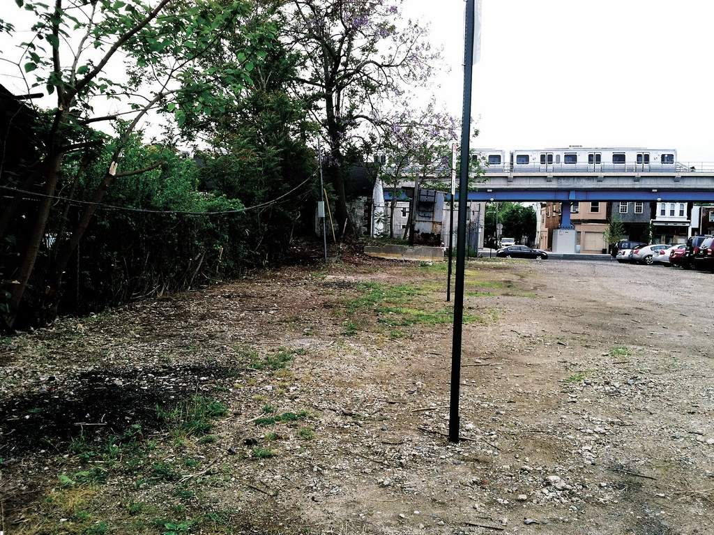 A SEPTA-owned section of a West Philly lot was a mess (below) until the Marquis got it cleaned up. (Phillip Lucas / Daily News Staff)