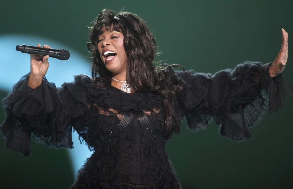 Donna Summer performs in 2009. She defined the disco era but had much more depth of talent.  JOHN McCONNICO / Associated Press