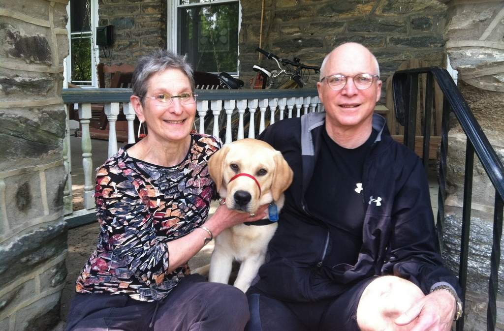 Michael and Linda Dzuba in West Mount Airy with a foster puppy. The Friends Life Care program allows them to stay in their house. JEFF GELLES / Staff