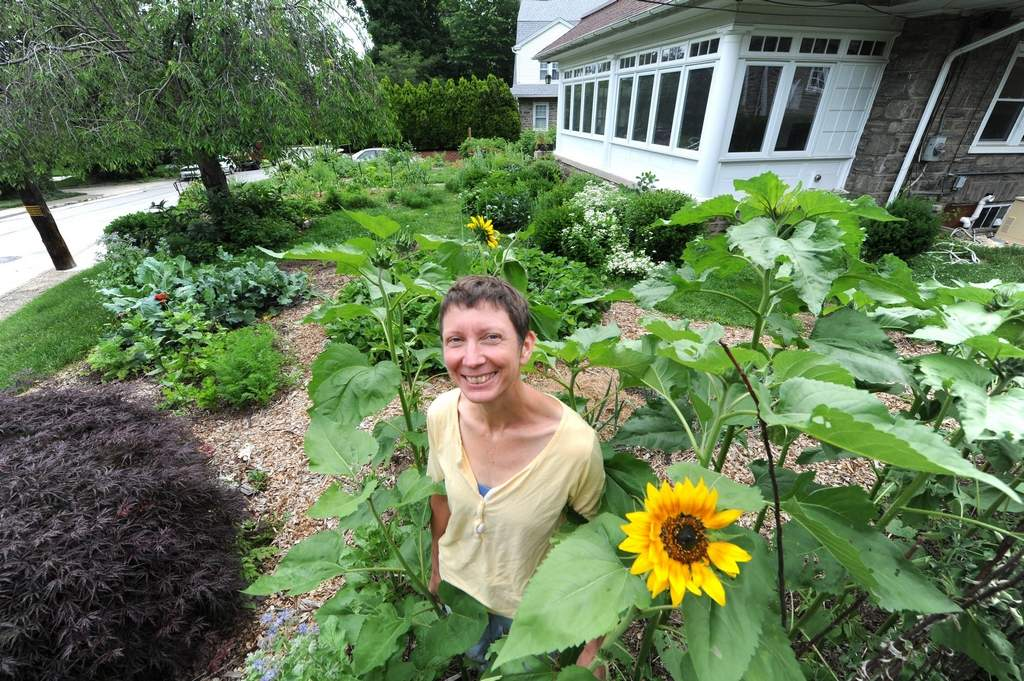Michaelann Velicky, 48, stands in her Elkins Park front yard garden bursting with vegetables, herbs and flowers Monday, June 4, 2012.  ( CLEM MURRAY / Staff Photographer )