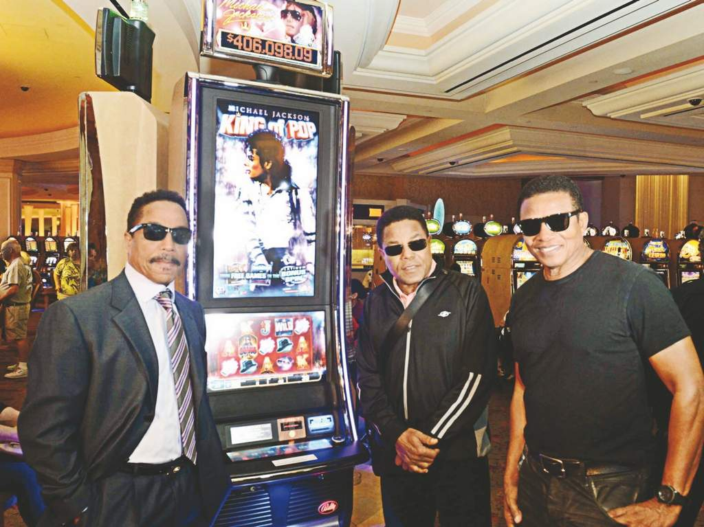 King of slots<br /><br />Marlon, Tito and Jackie Jackson (from left) unveiled the new Michael Jackson King of Pop video slot machines last Friday at the Borgata in Atlantic City. The three brothers performed with their sibling Jermaine at the hotel in a sold-out concert.