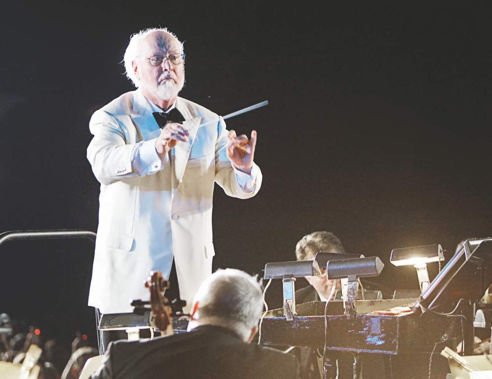 The Philadelphia Orchestra will pay tribute to John Williams, the man behind the scores of &quot;Jurassic Park,&quot; &quot;Star Wars&quot; and numerous other films, at the Mann Center on Friday.<br /><br />Photos: Associated Press