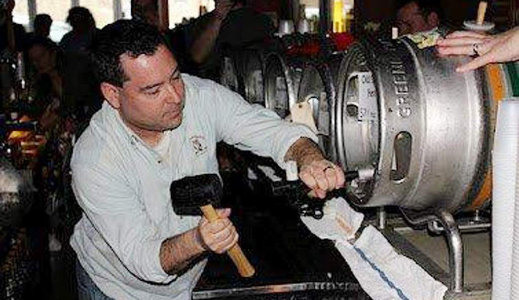Grey Lodge owner Mike Scotese taps a keg at a past Firkinteenth.