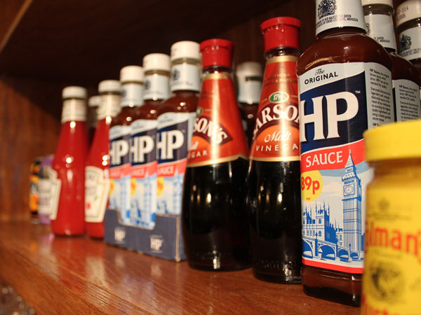 Condiments, including HP sauce, at The Victoria Freehouse.  MICHAEL KLEIN / Philly.com