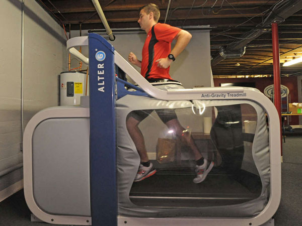 Ralph Harris of the Running Company of Haddonfield demonstrates the Alter G antigravity treadmill, which NASA developed to simulate weightlessness. APRIL SAUL / Staff Photographer