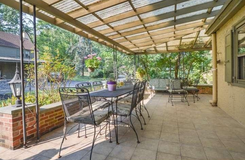 Plants In A Cold Climate: Not Only Is There A Delightful Detached Greenhouse  At This Suburban Manse, But There Is A Wisteria Covered Pergola. Wisteria!