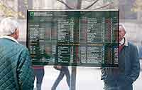 A stock exchange monitor in Milan on Nov. 9, 2011.  (Antonio Calanni / AP)