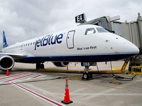 A JetBlue plane sits at the gate at Philadelphia International Airport on May 23, 2013. (CLEM MURRAY/Staff Photographer)